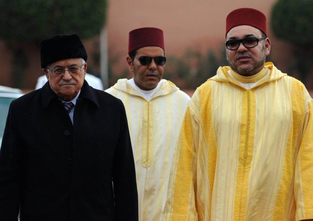 Mahmoud Abbas, président de l'Autorité palestinienne, en compagnie du roi Mohammed VI du Maroc en janvier 2014 à Marrakech lors de la réunion du comité Al-Qods de soutien au processus de paix au Moyen-Orient. ©  FADEL SENNA / AFP