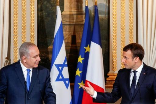 """Le président français Emmanuel Macron appelle le Premier ministre israélien Benjamin Netanyahu à """"des gestes courageux"""" pour les Palestiniens lors d'une conférence de presse à Paris © PHILIPPE WOJAZER POOL/AFP"""