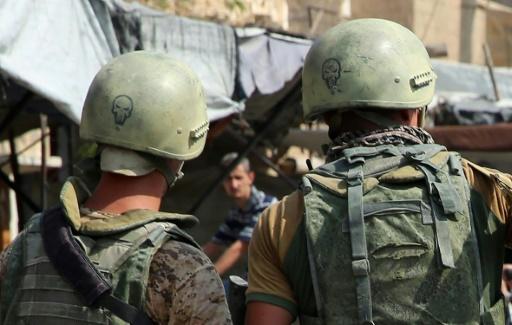 Photo prise lors d'un voyage de presse en Syrie organisé par la Russie, de soldats russes le 15 septembre 2017 en patrouille dans les rues de Deir Ezzor  © Dominique DERDA France2/AFP
