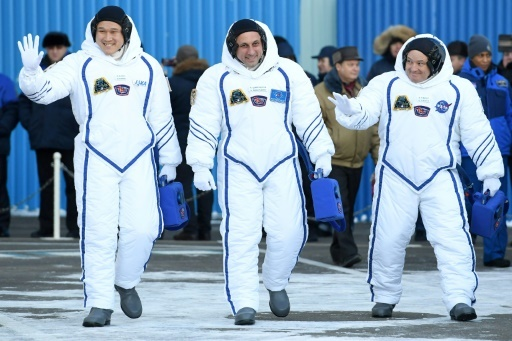 Les trois astronautes partis dimanche de Baïkonour pour la station spatiale internationale: Scott Tingle, Anton Shkaplerov et Norishige Kanai  © Kirill KUDRYAVTSEV AFP