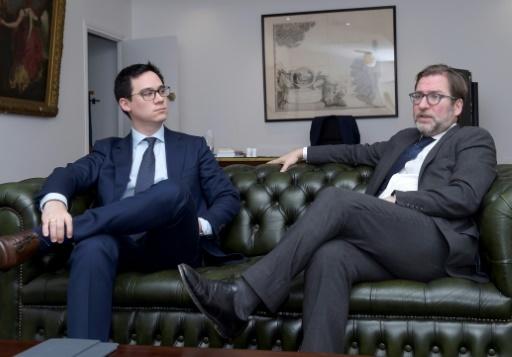 """Fabien Lehagre, président de l'""""Association des Américains accidentels"""" (g), et Patrice Spinosi, avocat de l'association (d) lors d'une interview à l'AFP, le 7 décembre 2017 © ERIC PIERMONT AFP"""