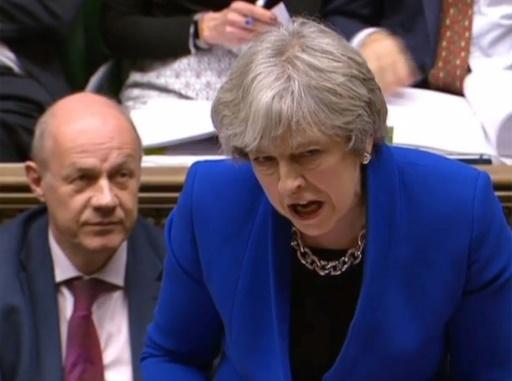 Image tirée d'une vidéo de la chaîne parlementaire (PRU) montrant la Première ministre britannique Theresa May (d) et son vice-Premier ministre Damian Green, le 20 décembre 2017 devant les députés à Londres ©  PRU/AFP/Archives