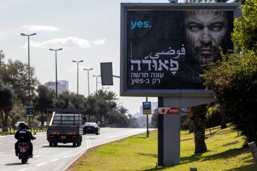 """Une publicité pour la série télévisée israélienne """"Fauda"""", le 31 décembre 2017 à Tel-Aviv © JACK GUEZ AFP"""