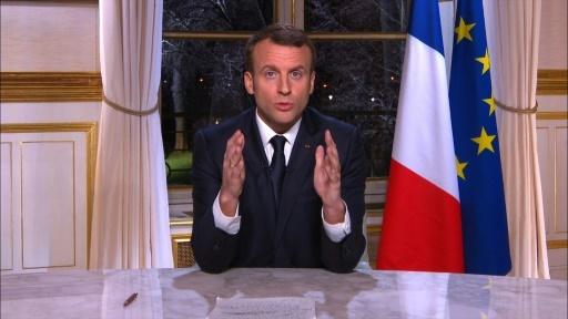 Capture d'écran du président français Emmanuel Macron lors de ses voeux pour la nouvelle année 2018, le 31 décembre 2017 à Paris © STRINGER AFP