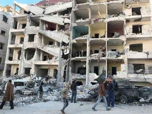 Bâtiments dévastés après l'explosion d'origine indéterminée près du quartier général de combattants jihadistes asiatiques à Idleb, le 8 janvier 2018 © OMAR HAJ KADOUR AFP