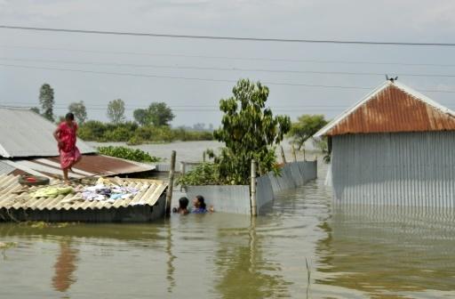 Le village d'Alal en Inde le 23 août 2017, victime d'inondations provoquées par la mousson qui a affecté aussi le Népal et le Bangladesh © DIPTENDU DUTTA AFP/Archives