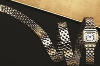 Montre Panthère en or à enrouler triplement autour du poignet.