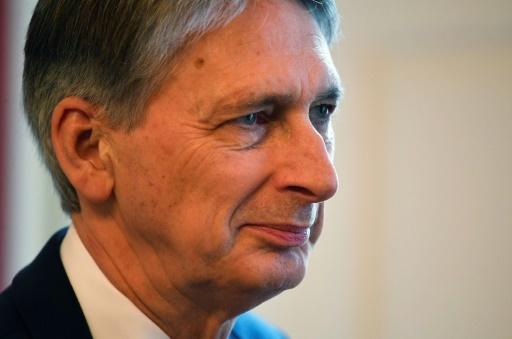 A Davos,le ministre britannique des Finances Philip Hammond, ici le 30 janvier 2018, a appelé à réguler le bitcoin © TOBY MELVILLE POOL/AFP/Archives