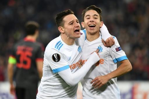 Les Marseillais Florian Thauvin et Maxime Lopez après un but contre Braga en Europa League, le 15 février 2018 au Vélodrome © BORIS HORVAT AFP/Archives