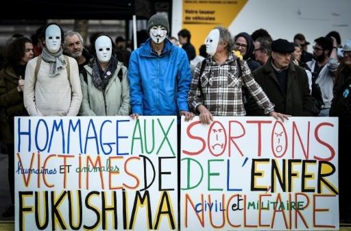 Manifestation pour sortir du nucléaire, sept ans après la catastrophe de Fukushima, le 11 mars 2018 à Paris © STEPHANE DE SAKUTIN AFP