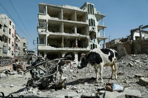 Bâtiment éventré à Douma, principale ville de la Ghouta orientale, près de Damas, le 12 mars 2018 © HASAN MOHAMED AFP
