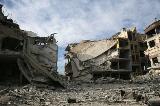 Des immeubles détruits dans des bombardements attribués au régime syrien sur la ville rebelle de Hammouriyé, dans la Ghouta orientale, en banlieue de Damas, le 13 mars 2018 © ABDULMONAM EASSA AFP