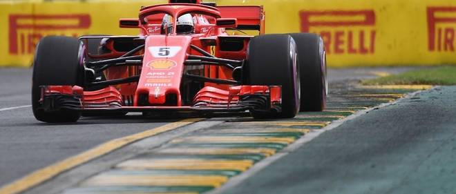 Ferrari's German driver Sebastian Vettel drives around the Albert Park circuit during the Formula One qualifying session in Melbourne on March 24, 2018, ahead of the Formula One Australian Grand Prix. / AFP PHOTO / SAEED KHAN / -- IMAGE RESTRICTED TO EDITORIAL USE - STRICTLY NO COMMERCIAL USE --