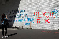 (FILES) In this file photo taken on April 06, 2018, a student takes a photo of a wall on which a quote reads