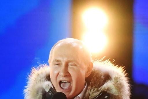 Le président russe Vladimir Poutine lors d'un rassemblement à Moscou pour le 4e anniversaire de l'annexion de la Crimée, le 18 mars 2018 après son élection pour le 4e mandat © Kirill KUDRYAVTSEV AFP/Archives