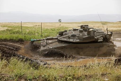 Un tank de l'armée israélienne sur le plateau du Golan, le 10 mai 2018 © MENAHEM KAHANA AFP