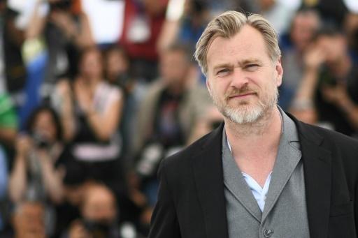 Le réalisateur britannique Christopher Nolan pose lors d'un photocall à Cannes, le 12 mai 2018 © Anne-Christine POUJOULAT AFP