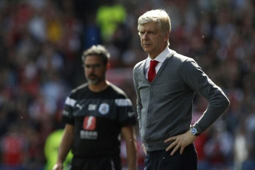 Dernier match pour Arsène Wenger comme manager d'Arsenal, vainqueur sur le terrain de Huddersfield Town, le 13 mai 2018 © Adrian DENNIS AFP