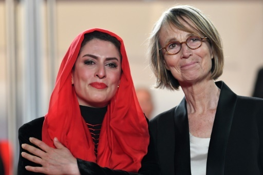 La ministre française de la Culture, Françoise Nyssen (d), et l'actrice iranienne Behnaz Jafari, au festival de Cannes le 12 mai 2018 © LOIC VENANCE AFP