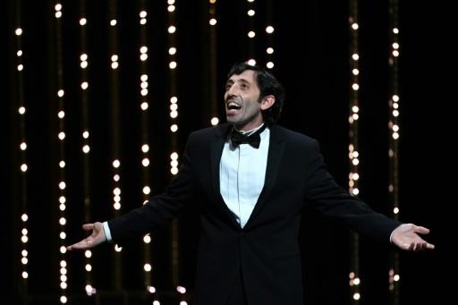 """L'acteur italien Marcello Fonte décroche le prix d'interprétation masculine en clôture du 71e Festival de Cannes, pour son interprétation dans """"Dogman"""", le 19 mai 2018 © Alberto PIZZOLI AFP"""