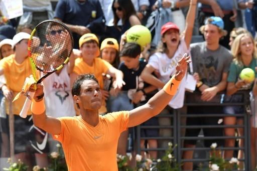 Rafael Nadal fête sa victoire sur l'Italien Fabio Fognini au Foro Italico, à Rome, le  18 mai 2018  © Andreas SOLARO AFP