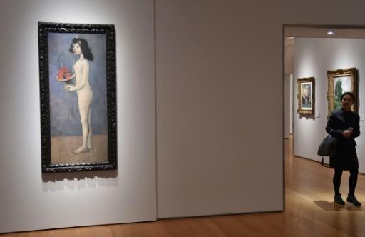 """La """"fillette à la corbeille fleurie"""" de Pablo Picasso, photo prise à New York le 27 avril 2018. Le tableau a été adjugé 115 millions de dollars.   © HECTOR RETAMAL AFP/Archives"""