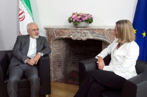 Le ministre iranien des Affaires étrangères Mohammad Zarif et la chef de la diplomatie de l'Union européenne Federica Mogherini, le 15 mai 2018 à Bruxelles © Thierry Monasse POOL/AFP