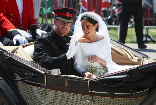 Le Prince Harry et sa femme Meghan après leur cérémonie de mariage à Windsor, le 19 mai 2018 © HANNAH MCKAY POOL/AFP