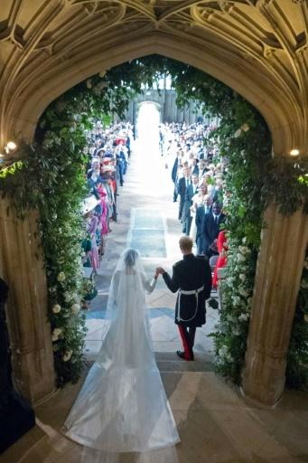 Le Prince Harry et sa femme Meghan sortent de la Chapelle Saint-George à Windsor, après la cérémonie, le 19 mai 2018 © Jonathan Brady POOL/AFP