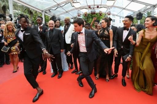 """Le réalisateur Gaspar Noe et l'équipe d'acteur de son film """"Climax"""", à Cannes 14 mai 2018 © Valery HACHE AFP/Archives"""