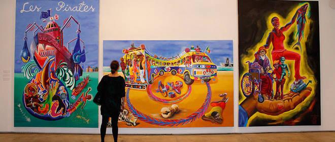Dakar Triptyque 2012, Acrylic on canvas, 300 x 700 cm (trois panneaux de 300                       x 200 cm chacun, par Teemu Mäki avec Nicodem Natrang, Bakary Sarr, Kiila Sarr,                       Thierno Seck, Mady Sima, Mouhamadou Bamba Touré lors de la Biennale de Dakar en mai 2012.