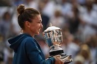 Simona Halep remporte son premier titre du grand chelem.  ©ERIC FEFERBERG