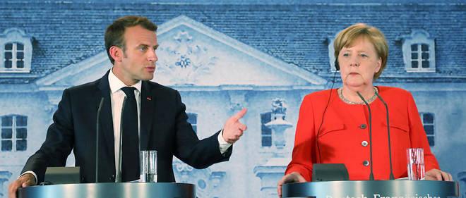 Emmanuel Macron et Angela Merkel à l'issue du conseil franco-allemand à Berlin.