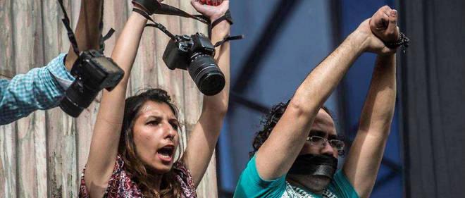 Le 3 mars, au Caire, des photojournalistes égyptiens manifestent contre le recul de la liberté de la presse