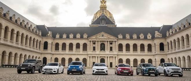 """Les sept prétendantes au titre de """"plus belle voiture de l'année"""", exposées mardi dernier dans la cour des Invalides. L'une d'entre elles succèdera à l'Alpine A110, distinguée l'an dernier."""