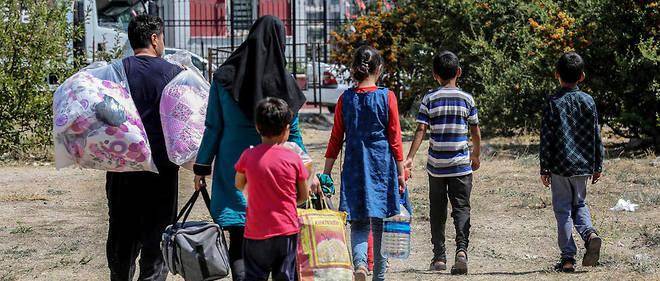 Des réfugiés afghans dans un camp de fortune à Ankara.