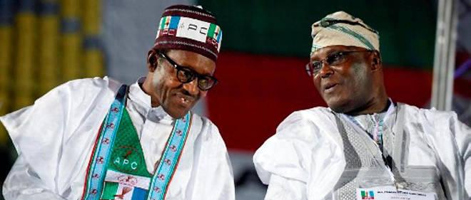 Le duel entre Muhammadu Buhari et Atiku Abubakar, ici côte à côte le 1er décembre 2014, s'annonce âpre.