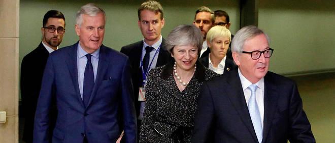 Le négociateur européen Michel Barnier, la Première ministre britannique Theresa May et le président de la Commission européenne Jean-Claude Juncker.FP)