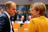 Le président du Conseil européen Donald Tusk et la chancelière allemande Angela Merkel lors d'un conseil à Bruxelles le 22 mars.