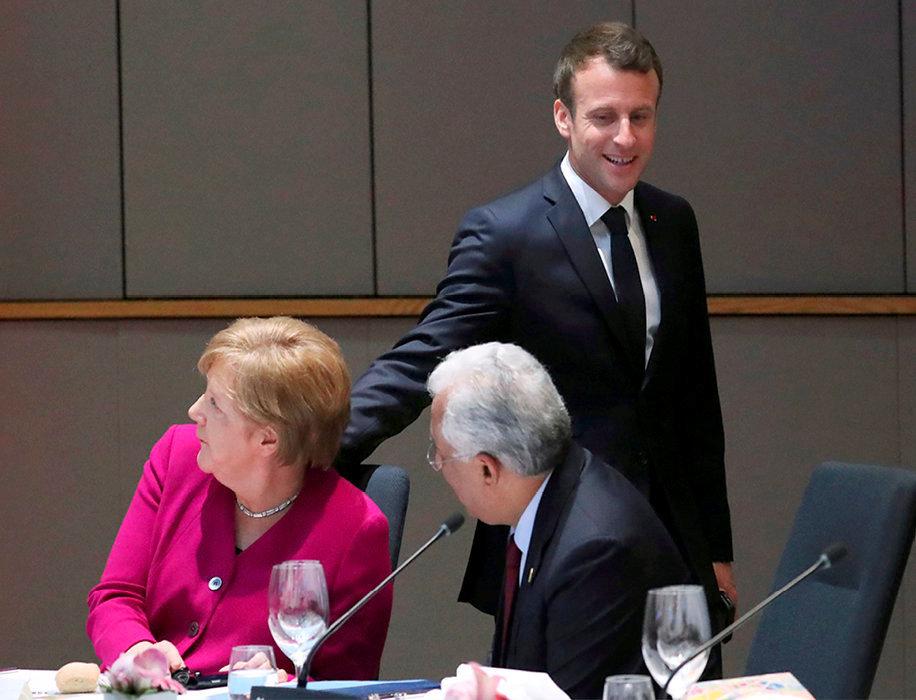 Divergences. Angela Merkel et Emmanuel Macron au QG de la Commission de Bruxelles, le 28mai, avec le Premier ministre portugais, Antonio Costa.