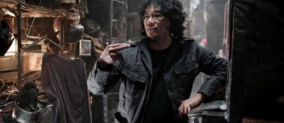 <p>Bong Joon Ho sur le tournage de Snowpiercer</p>