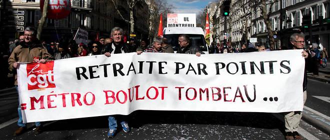 Des manifestants déflient contre la réforme des retraites envisagée, le 19 mars, à Paris.