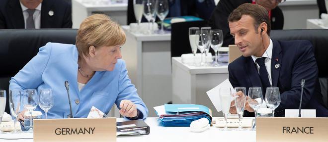 Apres d'interminables tractations, Merkel et Macron ont fini par tomber d'accord. Photo d'illustration des deux dirigeants lors du G20 a Osaka.