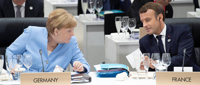 Après d'interminables tractations, Merkel et Macron ont fini par tomber d'accord. Photo d'illustration des deux dirigeants lors du G20 à Osaka.