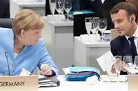 <p>Après d'interminables tractations, Merkel et Macron ont fini par tomber d'accord. Photo d'illustration des deux dirigeants lors du G20 à Osaka.</p>