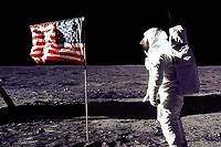"A photo released by NASA shows astronaut Edwin E. ""Buzz"" Aldrin Jr saluting the US flag on the surface of the Moon during the Apollo 11 lunar mission,20 July 1969. The 20th July 1999 marks the 30th anniversary of the Apollo 11 mission and man's first walk on the Moon. (Photo by NASA / AFP)"