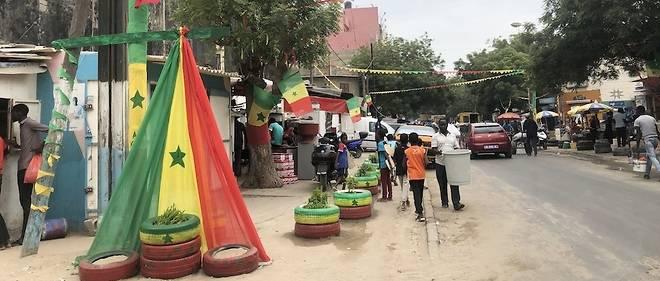 La ferveur est partout dans les rues de Dakar.