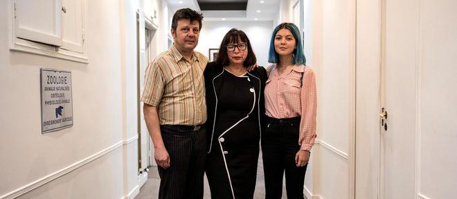 Le couple Mennesson et une de leurs filles, Fiorella, en 2018.