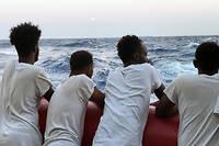 Migrants a bord du navire de sauvetage << Ocean Viking >>, opere par des ONG, le 14 aout 2019, en mer Mediterranee.