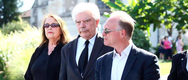 Bernard Pradinaud et sa femme lors des funérailles de Gonzague Saint Bris àAmboise, en août 2017.